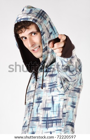 young stylish man in hood pointing for finger at camera