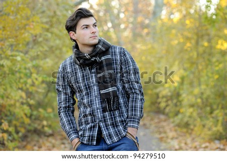 Young stylish man portrait in autumn park. Outdoor.