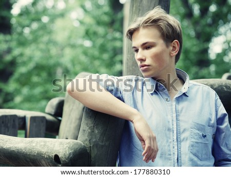 Young stylish man portrait in summer park. Outdoor.