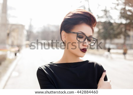 Young stylish woman walking in a city street