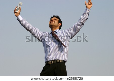 Young successful business man happy getting a contract over mobile