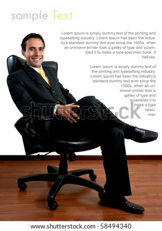 Young successful business man sitting at his office with copy space