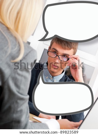 Young successful business people are working in the office. Blank balloon of their dialog with copyspace - stock photo