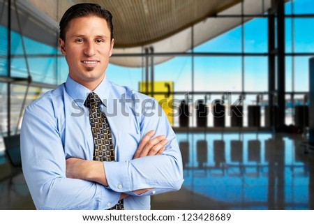 Young successful businessman at airport - stock photo
