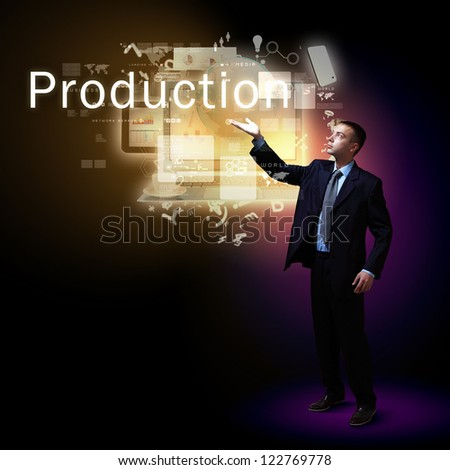 Young successful businessman holding a shining light in his hand as a symbol of success and advancement. - stock photo