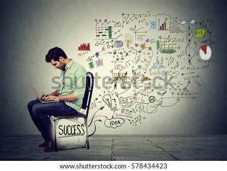 young successful businessman working on computer #578434423