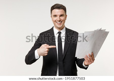 Young successful employee business corporate lawyer man 20s wearing classic formal black grey suit shirt tie work in office point finger on paper account documents isolated on white background studio. ストックフォト ©