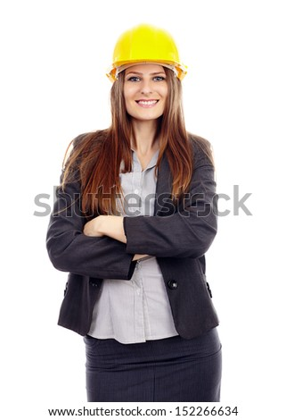 Young successful female engineer with arms folded wearing a  protection helmet isolated on white background