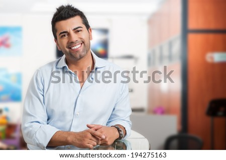 Young successful man at office