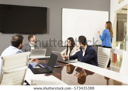 Young successful managers discussing new business project in modern office