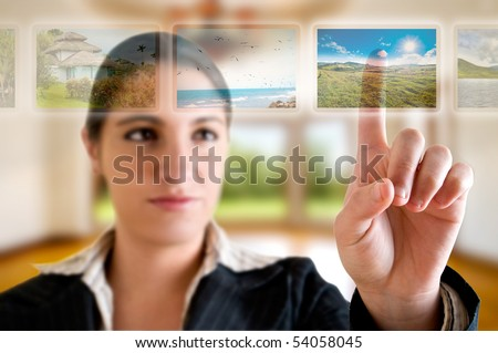 Young successful woman planning her vacations choosing options from digital touching screen