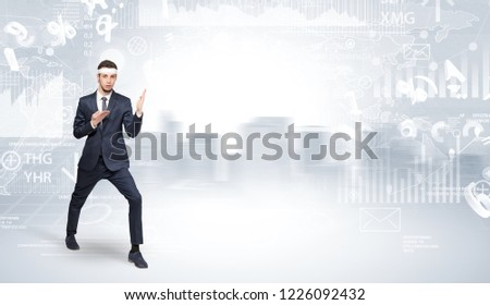 Young suited karate trainer doing karate tricks on the top of a metropolitan city #1226092432