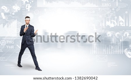 Young suited karate trainer doing karate tricks on the top of a metropolitan city #1382690042