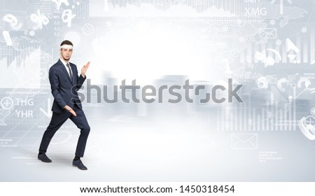 Young suited karate trainer doing karate tricks on the top of a metropolitan city #1450318454