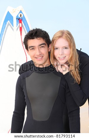 Young surf couple
