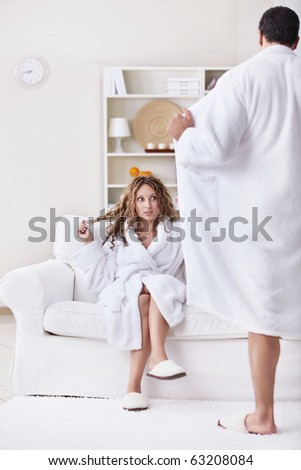 Young surprised girl and a man opened its robe
