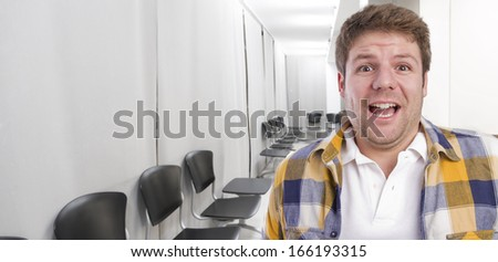 young surprised  man in office or waiting room