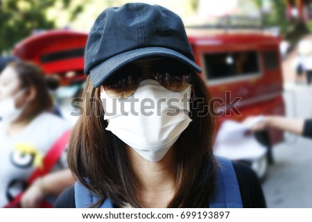 Young suspects wears a hat, wears glasses, and wears a gag. To cover face, The Ministry of Health has campaigned for people with influenza. Wear a mask to prevent the disease from spreading. #699193897