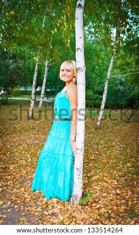 Young tanned girl in a birch grove. Moldavia
