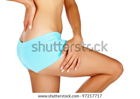 Young tanned woman with beautiful sporty buttocks and slim waistline - isolated on white wearing blue shorts style underwear