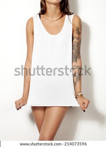 Young tattooed woman wearing blank sleeveless t-shirt