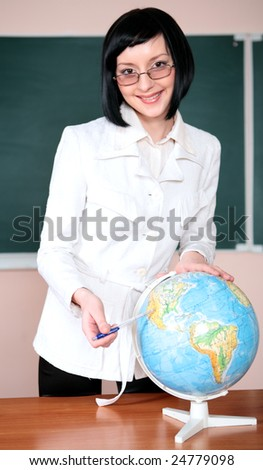 young teacher woman on green board in classroom