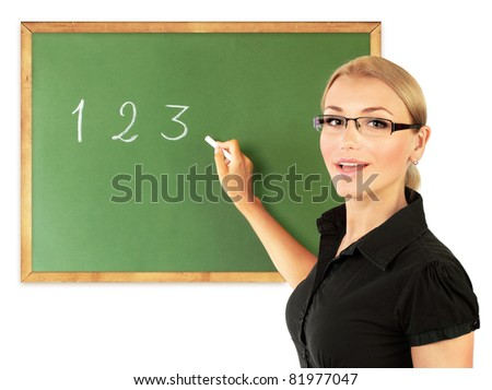Young teacher writing numbers on the chalkboard, isolated on white background, conceptual image of education
