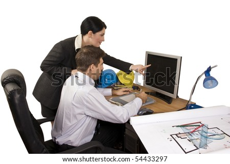 Young team of architects in office working,architect woman pointing on computer screen