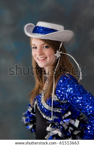 stock photo : Young teen age girl cheerleader dressed in school uniform on ...