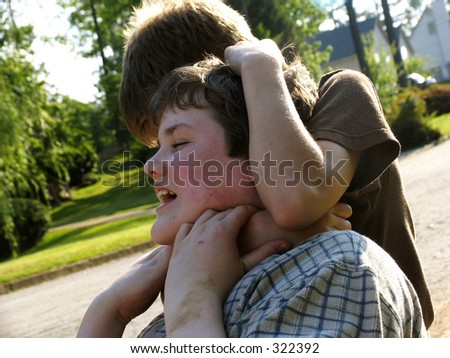 stock photo : young teen boys fighting
