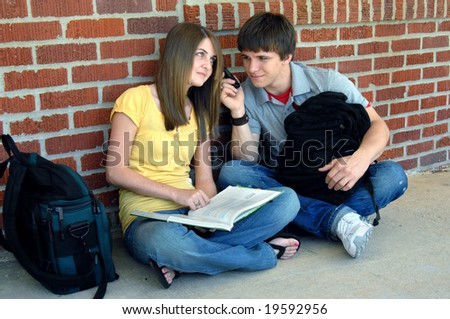 stock photo young teen couple sit on sidewalk at school and share a cell phone during break female holds open 19592956 Couple fucking mature picture