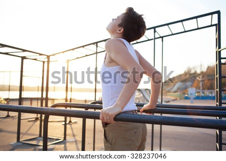 young teen girl training on parallel bars outdoors #328237046