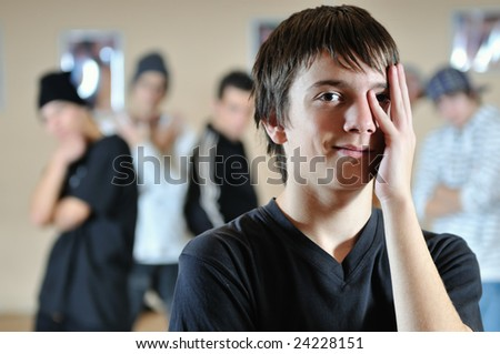 young teen hidding face with hand