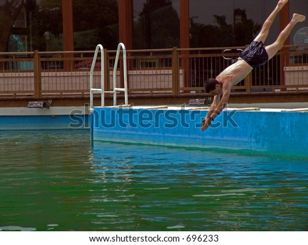 Young Teen Male Diving Into Swimming Pool Mid Air Action Shot Stock Photo 696233 Shutterstock
