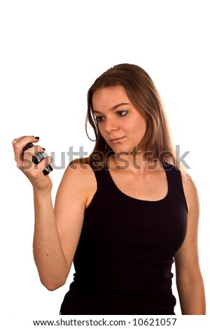 stock photo : Young teen model with a cell phone, isolated against white