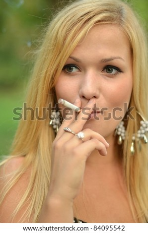 stock photo young teen person smoking cigarette outdoors 84095542 Having watery discharge on a frequent basis during pregnancy is quite common ...
