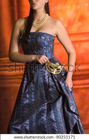 Young Teen woman at Masquerade Ball with long dark hair