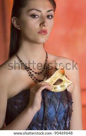Young Teen woman at Masquerade Ball with long dark hair