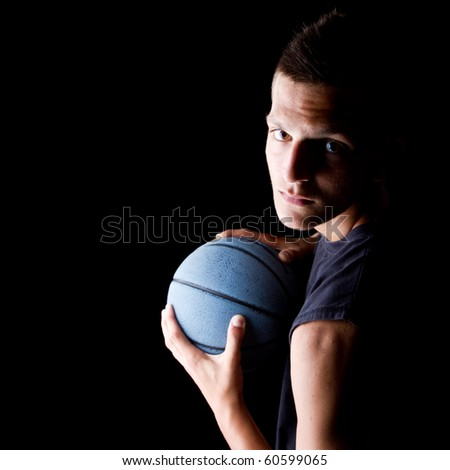 Young teenage basketball player in a studio setting with hip athletic clothing.