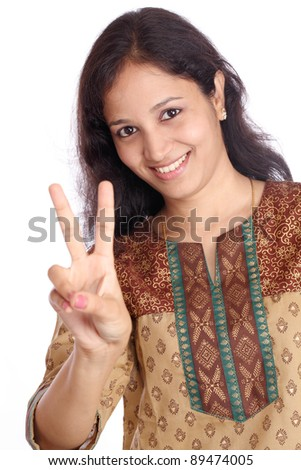 young teenage girl doing victory sign