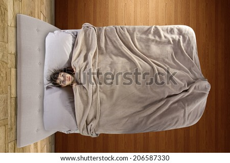 young teenage girl scared alone in the bedroom