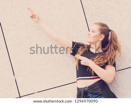e43312f0d46a Young teenage woman wearing denim shorts and black crop top. Female  presenting fashionable summer outfit