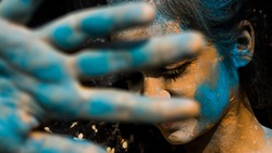 Young teenager girl celebrating holi with colors. holi is a festival of India. It is festival of colors and Joy. It is also called as Dhuleti.