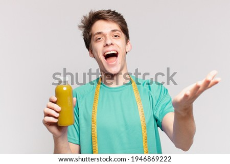 young teenager man surprised expression and holding a soothy. diet concept Foto stock ©