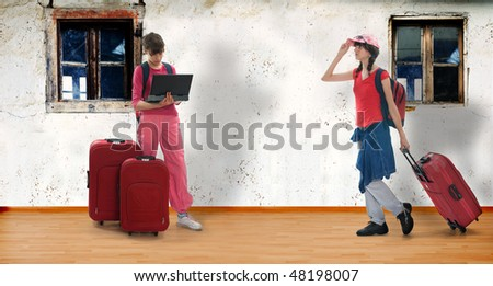 Young teenagers with huge luggage in old room with wooden floor