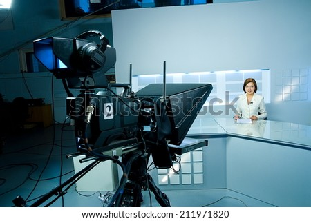 young television announcer at studio during live broadcasting