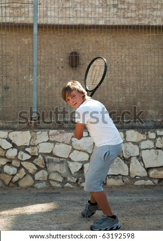 young tennis player in action .