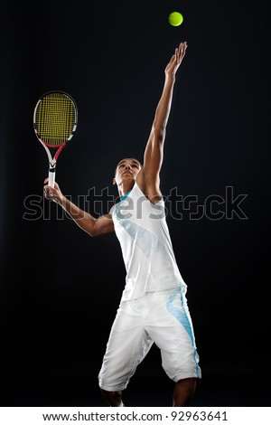 Young tennis player with racket ready to serve a tennis ball
