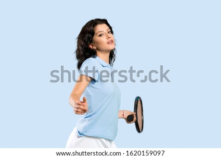 Young tennis player woman over isolated background over isolated background