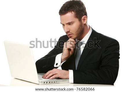 Young thoughtful business man working at the notebook - stock photo